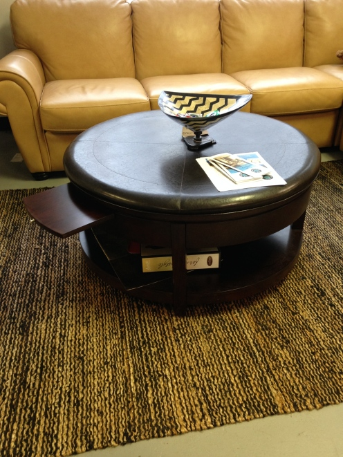 Magnusen Home Brunswick Cocktail Table. Faux Leather Top. 2 slide out trays, one deawer. FLOOR MODEL SALE: $404.99 (Reg. $899.00)