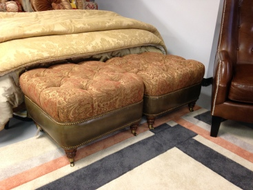 A Pair of Taylor King ottomans in fabric and leather combo. Sold seperatly. FLOOR MODEL SALE: $699.99 each.