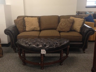 Wayatt Sofa by Taylor King, houndstooth and leather. SALE: $1999.99 (Reg.3,999.98 $ ) Demilune Cocktail Ottoman by Taylor King SALE: $525.60 (Reg. $1168.00 )